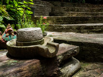 Ancient millstone have green lichen around and Ancient millstone Royalty Free Stock Images