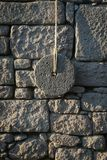 Ancient Millstone On The Wall stock images
