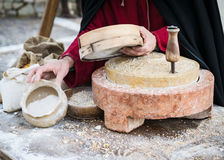 Ancient millstone that was turned by hand to produce flour. Stock Photos
