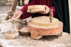 Ancient millstone that was turned by hand to produce flour. Royalty Free Stock Images