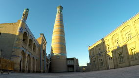 Ancient minaret on the street of the old city. Uzbekistan. Khiva. stock footage