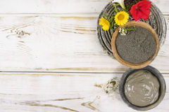 Ancient minerals - black clay powder and mud mask for spa and be Stock Photos
