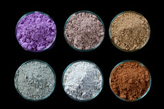 Ancient minerals - Clay of several colorsclay powder and mud mask for spa, beauty concept crop on black background Stock Photography