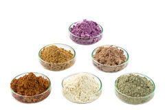 Ancient minerals - Clay of several colorsclay powder and mud mask for spa, beauty concept crop on white background Royalty Free Stock Image