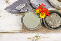 Ancient minerals - green clay powder and mud mask for spa and be Royalty Free Stock Photo