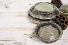 Ancient minerals - green clay powder and mud mask for spa and be Royalty Free Stock Photos