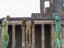 Ancient and modern. Modern art sculptures of the Polish sculptor Igor Mitoraj on display at the ancient Pompeii archaeological site, Campania, Italy Royalty Free Stock Images