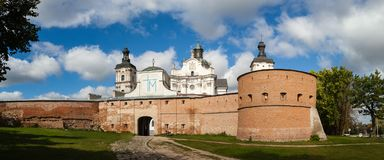 Ancient monastery of Discalced Carmelites, cathedral and fortres. S wall on background of blue cloudy sky. City Berdychiv, Ukraine. Tourist attraction. Place of Royalty Free Stock Image
