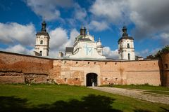 Ancient monastery of Discalced Carmelites, cathedral and fortres. S wall on background of blue cloudy sky. City Berdychiv, Ukraine. Tourist attraction. Place of Stock Photos