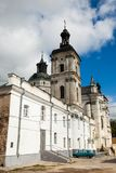 Ancient monastery of Discalced Carmelites, cathedral and fortres. S wall on background of blue cloudy sky. City Berdychiv, Ukraine. Tourist attraction. Place of Royalty Free Stock Images