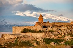 Ancient monastery in front of mountain. Ancient monastery Khor Virap in Armenia with Ararat mountain at background at sunrise. Was founded in years 642-1662 Royalty Free Stock Photos