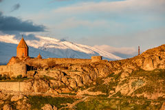 Ancient monastery in front of mountain. Ancient monastery Khor Virap in Armenia with Ararat mountain at background at sunrise. Was founded in years 642-1662 Stock Photography