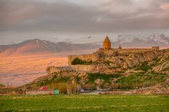 Ancient monastery in front of mountain. Ancient monastery Khor Virap in Armenia with Ararat mountain at background at sunrise. Was founded in years 642-1662 Royalty Free Stock Image