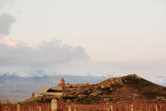Ancient monastery in front of mountain. Ancient monastery Khor Virap in Armenia with Ararat mountain at background. Was founded in years 642-1662 Royalty Free Stock Image