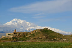 Ancient monastery in front of mountain. Ancient monastery Khor Virap in Armenia with Ararat mountain at background. Was founded in years 642-1662 Stock Photo