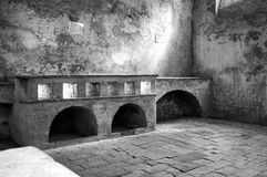 Ancient monastery kitchens. Black and white photo Stock Photo