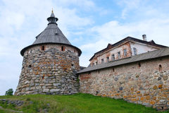 Ancient monastery tower and fragment of wall Royalty Free Stock Image