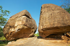 Ancient monks meditation caves under big rocks in Anuradhapura, Sri Lanka. Stock Photo
