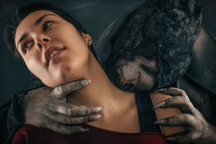 Ancient monster vampire demon bites a woman neck. Halloween fant Royalty Free Stock Images