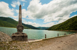 Ancient monument on shore of the lake, Stock Images