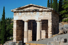 Ancient monumental building. Treasury of Apollo's temple located on ancient Delphi oracle in Greece mountains stock photography