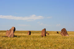 Ancient monuments of Khakassia. Variant one. Ancient monuments of Khakassia on the steppe background. Variant one Royalty Free Stock Photos