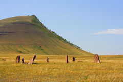 Ancient monuments of Khakassia. Variant two. Ancient monuments of Khakassia on the hill background. Variant two Stock Images