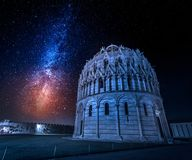 Ancient monuments in Pisa and milky way, Italy royalty free stock image