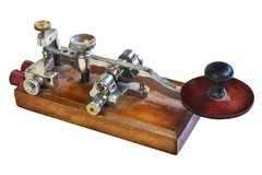 Ancient morse code telegraphy device. Isolated on a white background stock images