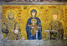 Ancient mosaic in Hagia Sophia, Istanbul, Turkey. ISTANBUL - MAY 25, 2013: Ancient mosaic in Hagia Sophia: Virgin Mary with Christ and the imperial family. Hagia stock images