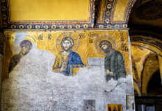 Ancient mosaic with Jesus Christ in Hagia Sophia, Istanbul. ISTANBUL - MAY 25, 2013: Ancient mosaic with Jesus Christ in Hagia Sophia. Hagia Sophia is the royalty free stock image