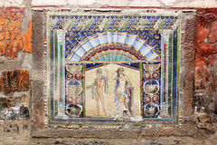 Ancient mosaic in Roman Herculaneum, Italy. Ancient Roman mosaic with Neptune and Amphitrite, on display in the House of Neptune and Amphitrite in the destroyed Royalty Free Stock Photo