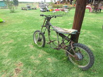 An ancient motor bike. This ancient motor bike was found at an antique shop in Fouriesburg in the Free State South Africa Stock Photos