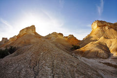 Ancient mountains in desert on a sunset Stock Photography