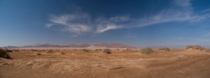 Ancient mountains of Sinai desert. Later afternoon light on a remote sandy desert stock image