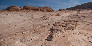 Ancient mountains of Sinai desert. Later afternoon light on a remote sandy desert royalty free stock photography