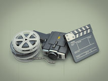 Ancient movie camera near a clapperboard and a film. On a retro background. 3d render image Royalty Free Stock Images