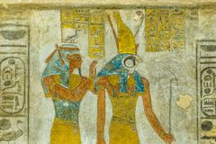 Ancient Mural of the egyptian goddess Maat and the god Horus. Painting of the egyptian goddess Maat and the god Horus in KV 14, the tomb of Tausert and Setnakht stock photography