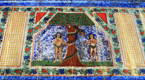 Ancient Mural Fresco Adam and Eve in Romania. Ancient mural fresco on wood with Adam and Eve in Maramures, Romania Stock Photo