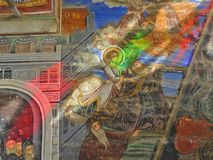 Ancient murals in monastery in holy Mount Athos Greece, covered with light passing through a colored stained glass. Royalty Free Stock Photography