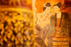 Ancient murals painting of man whispering to woman, famous mural painting at Wat Phumin, a famous buddhist temple in Nan Province stock photography