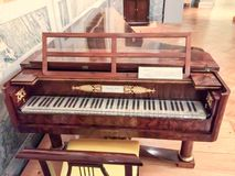 Antique musical instrument. Ancient musical instrument, museum of Vienna, painting, carving, haze, vignetting royalty free stock photo