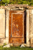 Ancient Mysterious Rusted Door in Sandstone Frame Stock Photo