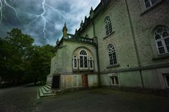 Ancient mystical  house during a thunderstorm Royalty Free Stock Photo