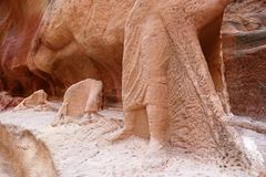Ancient Nabataean Camel Rider Statue and Camel Caravans Ruins in Petra, Jordan. Ancient Nabataean Rock Carving Camel Rider Statue and Camel Caravans Ruins inside stock photos