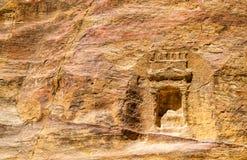 Ancient Nabataean Rock Carvings at the Siq in Petra Royalty Free Stock Photos