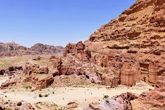 Ancient Nabataean Royal Tombs Complex Ruins in The Lost City of Petra, Jordan. Scenic View Ancient Nabataean Rock-Cut Royal Tombs Complex Ruins on Rose Red Color stock photo