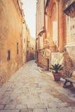Ancient narrow street in Mdina, Malta Royalty Free Stock Photo
