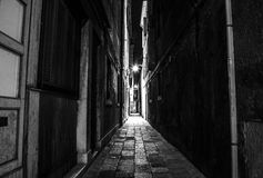 Ancient narrow streets and facades of old medieval buildings at night time close-up. Venice, Italy Stock Image