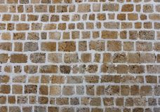 Ancient natural stone wall as a texture or background. Ancient natural stone wall as a texture or background stock photography